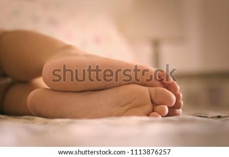 Lazy Feet Resting #1113876257