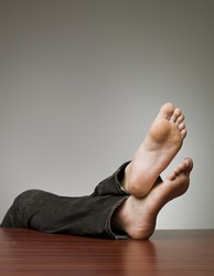 Lazy man with his feet at the table