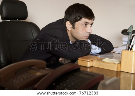 lazy stressed businessman thinking in his office