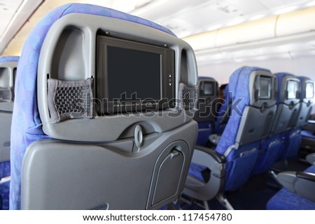 LCD monitor on Passenger Seat of airplane with empty copy space