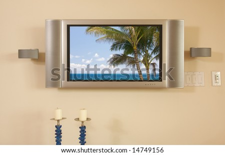 LCD TV & Speakers mounted on the wall.