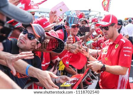 Le Castellet, France. 23/06/2018. Grand Prix of France. F1 World Championship 2018. Sebastian Vettel, Ferrari, with fans doing autographs. - Shutterstock ID 1118702540