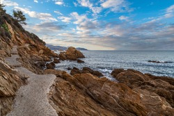 Le Lavandou, France. Ecological stone trail along the rocky coast of Mediterranean sea. Provence, French Riviera.