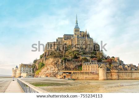 Le Mont Saint Michel, an UNESCO world heritage site in France on a sundown