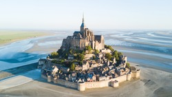 Le Mont Saint-Michel tidal island in beautiful twilight at dusk, Normandy, France