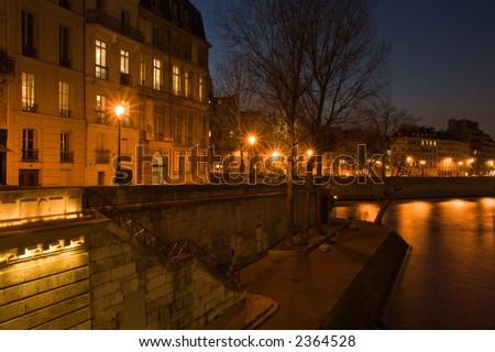 Le quai de Bourbon at dusk - Paris, France