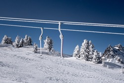 Le Tour, France - 11 February, 2020: Ski lifts closed due to Covid-19 pandemic restrictions covered by ice and snow after snow storm