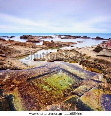 Le Vaschette water pool and rocks, coastal seascape near Livorno.Long exposure photography, Italy.