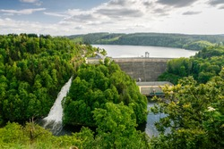 lead hole Dam is a congrete dam across the lead mountains and saale river, overflow, rare event, Saalburg, Thuringia, Germany