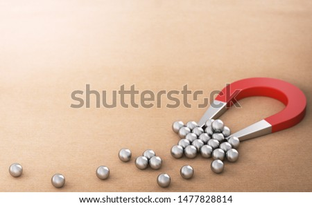 Lead Magnet over paper background attracting and retaining many spheres, symbol of new customers. B2B inbound marketing concept. 3D illustration
