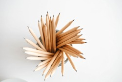 lead pencil in office cup with white background, top view