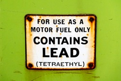 Leaded gasoline was the primary fuel type produced and sold in America until 1975, as depicted by this sign on an old gas pump (