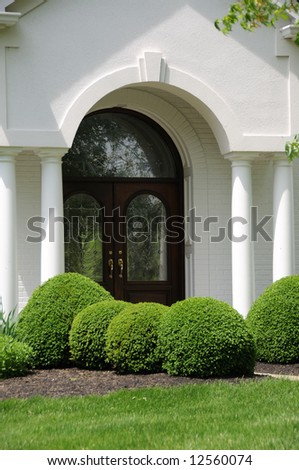 Leaded Glass Entry Door on a White Stucco Residence