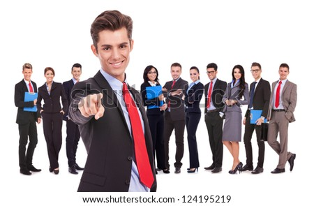 leader of a successful business team is choosing you to join them by pointing his finger