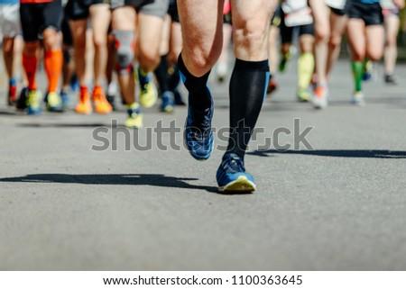 leader runner athlete run ahead group of runners #1100363645