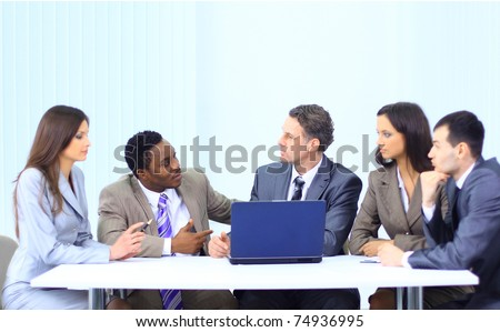 Leader with his successful team discussing in conference room