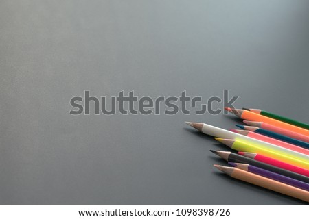 Leadership business concept. white color pencil lead other share idea on black background with copy space