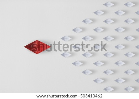 Leadership concept minimal  with red paper ship leading among paper ship white. #503410462