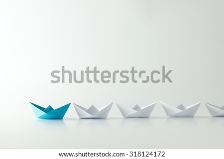 Shutterstock Leadership concept with blue paper ship leading among white