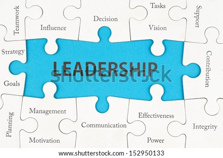 Leadership concept with group of jigsaw puzzle pieces
