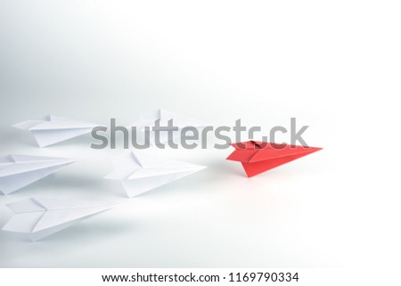 Leadership concept with red paper plane leading among white. Stock photo ©