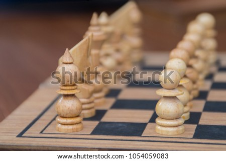 Leadership Concepts. Chess is a leader.  Comparing chess is a strategic business plan. Businessman is playing chess. Chess game on a black background. #1054059083
