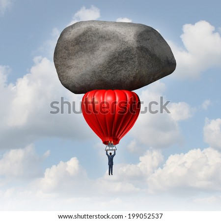 Leadership power and business challenges concept as a businessman piloting a red hot air balloon with a huge heavy rock slowing the rise as an obstacle to career and financial success.