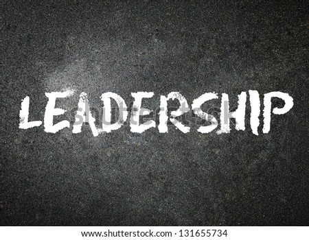 Leadership with white chalk on a blackboard. - stock photo