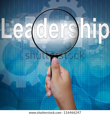 Leadership, word in Magnifying glass ,business background