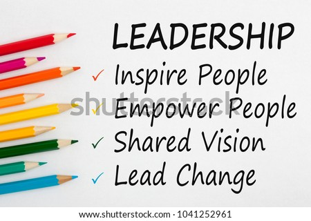 LEADERSHIP written on a white background and colour pencils. Business concept.Top view. #1041252961
