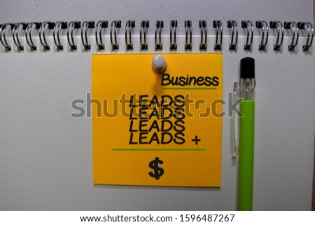 Leads plus Leads equal Money write on sticky note isolated on Office Desk