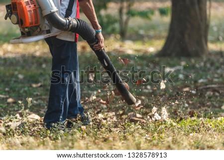 Leaf blower,gardener,Man working with leaf blower.