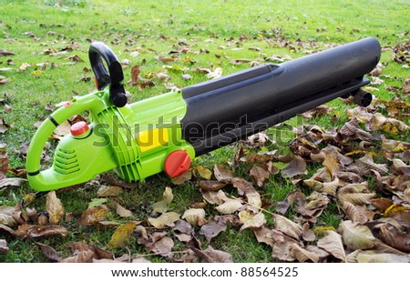 Leaf blower on the ground.