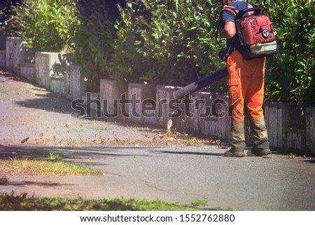 Leaf blower. Working on the street with this tool that blows the dry leaves #1552762880