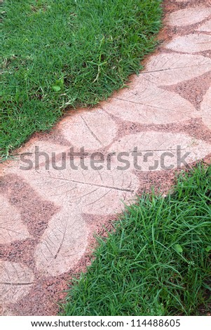 Leaf pattern on the stone pavement.