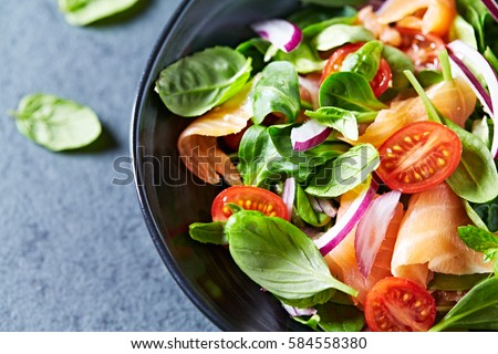 Leaf vegetable salad with smoked salmon #584558380