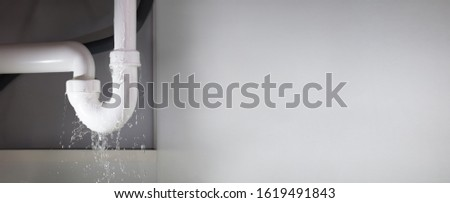 Leakage Of Water From Stainless Steel Pipe On Gray Background Foto stock ©