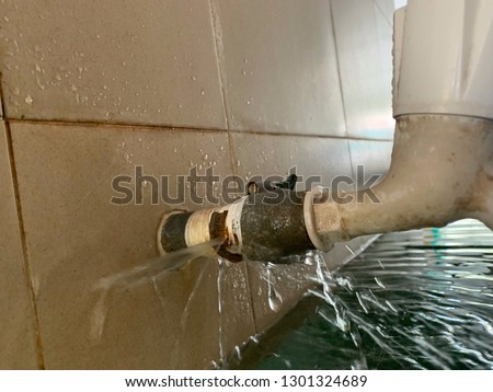 leaking fire pipeline joints. Image contain certain grain or noise and soft focus. Foto stock ©