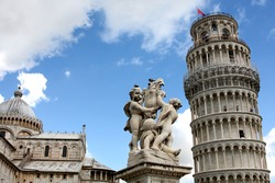 Leaning tower and statue angel in Pisa, Tuscany, Italy