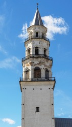 Leaning Tower of Nevyansk in summer day. The top and tiers of tower in the town of Nevyansk in Sverdlovsk Oblast, Russia built in the 18th century. Close up.