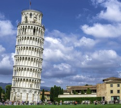 Leaning Tower of Pisa. Blue cloudy sky background