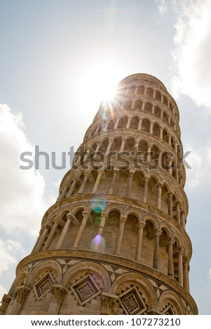 Leaning tower of Pisa - Italy : sun peaks over creating a natural lens flare