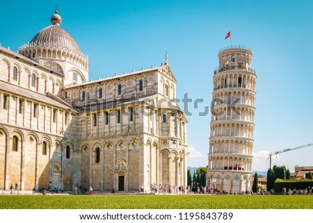 Leaning tower of Pisa, Italy with Basilica and Cathedral on a bright summer day with green gras low angle Zdjęcia stock ©