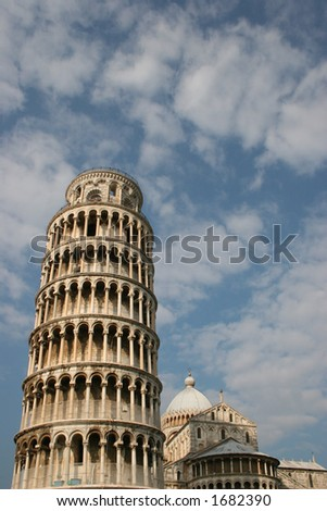 Leaning Tower of Pisa with blue sky and clouds.