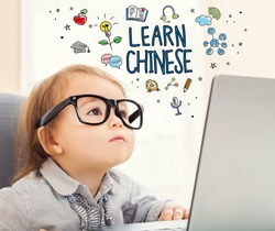 Learn Chinese concept with toddler girl using her laptop