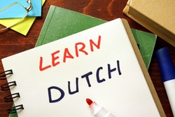 Learn dutch written in a notepad.  Education concept.