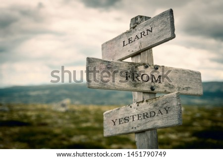 Learn from yesterday text on wooden signpost outdoors in nature, Quote, message, symbol, business, corporate, business, commercial concept. #1451790749