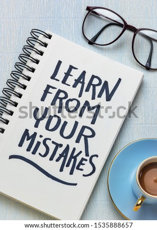 Learn from your mistakes reminder - handwriting in a sketchbook with a cup of coffee, learning, determination and perseverance concept