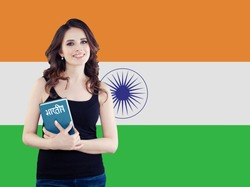 Learn hindi language. Attractive woman student with the India flag