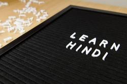 learn Hindi language sign on black background